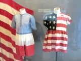 these dresses were made for young French girls from US parachute cloth, and worn for celebrations one year after D-Day