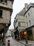 half-timbered buildings project over the streets...