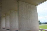 Names of the dead are listed on pillars at the cemetery.