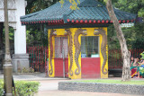 A ticket booth with dragons. Note the sign that says, Comfort Room Inside.