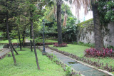 Pathway, wall and gardens at the Rizal Shrine.