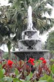 Plaza Armas fountain with flowers in the foreground.