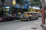 Another jeepney called San Roque.
