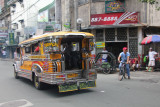 The rear of the jeepney where the passengers pile in.