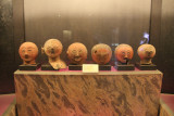 Anthropomorphic jar covers from the Ayub Cave with faces that were originally painted red and black.