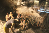 Depiction of archeologists excavating a site.