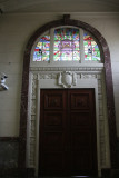 Stained glass window over the door of Marble Hall.