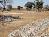 Stones from the former gold mine are cut into pieces and sold for house building, Laongo, Burkina Faso