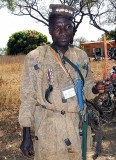 Hunter (Turka tribe) with grigris (amulets) that shall prevent him from getting wounded. Burkina Faso.