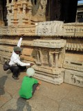 Examining the Vitthala Temple with our guide