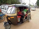 Leaving an autorickshaw