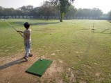 Siri Fort Par Three, Second Hole.  Swing and miss.