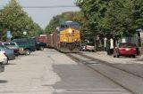 SB rack train street running through La Grange