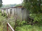 Wooden boxcar used as a farm shack