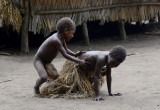 A young Yakel boy playing with a girl