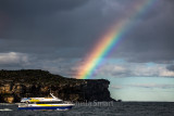 Manly fast ferry with rainbow on Sydney Harbour