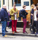 Blokes in Colourful Trousers in a Queue