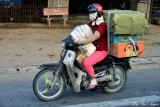 fully loaded masked scooter driver, My Tho, Vietnam