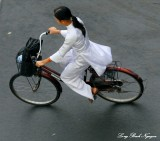 school girl in ao dai, Saigon, Vietnam