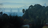 Morning. 500mm handheld zoom-in on Bay Bridge. Day 2, w/ default compression. 0136