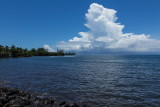 Clouds towering over Tahiti from Moorea