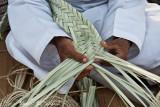 Weaving palm tree leaves