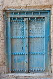 Engraved Blue wooden door