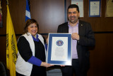 Evangelia and the prefect of Grevena with the Guinness Book of Records certificate for the longest tusks in the Milia Museum