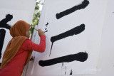 Chinese calligraphy by a Malay girl (8434)