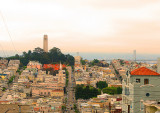 The golden skyline of SF from Lombard St