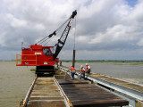 Crane Lifts a Needle from the Bay to Allow River to Flow Through