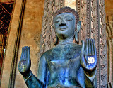 One of a pair of standing Buddhas at the front of the temple