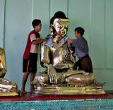 Polishing a Buddha image