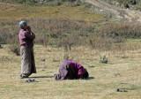 Praying outside Kurjey Lhakhang
