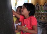 Girls reading the Maha Tissada bell