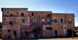 A clever painting of an indian adobe dwelling on a building facade in Cortez, CO.