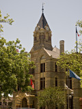A view of the Fayette County Courthouse clock tower.