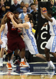 Tar Heels F Hansbrough ties up Hokies F Thompson to give the Heels the turnover and end the game
