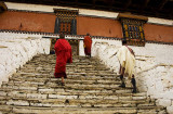 Monks walking up to the Entry of the Paro Dzong