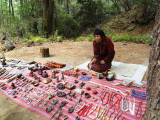 A Bhutanese woman offering her ware on a hand woven cloth