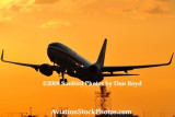 2009 - American Airlines B737-823 taking off at sunset aviation stock photo #3263