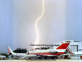 1988 - lightning striking in Miami Springs beyond aircraft parked south of the Midway hangar