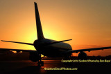 2010 - United Airlines B757 at sunset aviation stock photo #0413