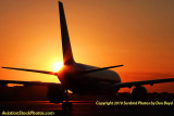 2010 - United Airlines B757 at sunset aviation stock photo #0414