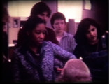 Etheline First black art director, presenting strong soire cut to staff in 1977.