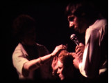 Christopher Brooker commenting and Pat cutting Havington's hair on-stage  Lancaster Gate hotel. 1975