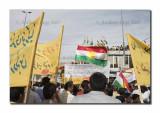 Kurdish flag between the yellow