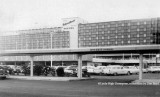 1959- the ground level parking lot and the new terminal at Miami International Airport after hotel added