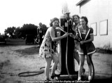 1940's - Ann Zink (pointing the hose) and two girlfriends at a gas station on North Miami Avenue