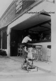1942 - Kenny Zink in front of his dad's bar, the Grove Inn, at 1480 NW 27 Avenue, Miami